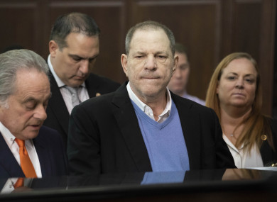 Harvey Weinstein (centre) listens during a court proceeding in New York.