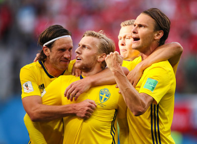 Forsberg celebrates with team-mates after giving the Sweden the lead.