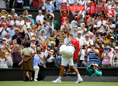 Standing ovation: Federer eased through on Monday afternoon.