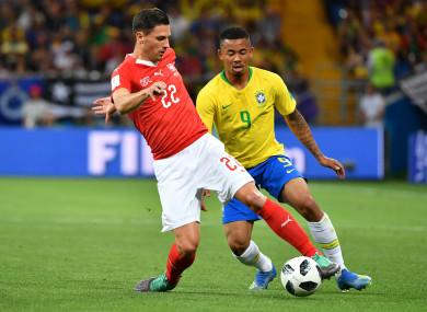 Switzerland's Fabian Schaer under pressure from Gabriel Jesus of Brazil at the 2018 World Cup.