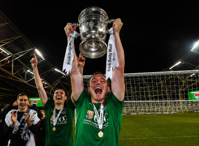 Achille Campion celebrates with the FAI Cup after Cork City's win over Dundalk in last November's final.