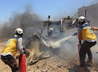 Members of the White Helmets respond to an attack last month