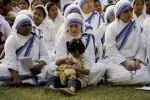 2016 photo of nuns from The Missionaries of Charity with an orphan girl in Kolkata.