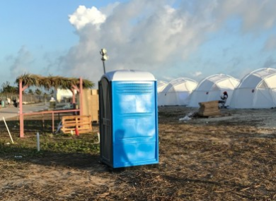 Tents and a portable toilet at the Fyre Festival.
