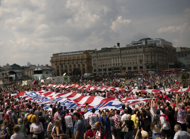 Croatia fans wave giant Croatia banners as they cheer at the Manezhnaya Square before the World Cup final.