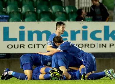 Limerick players celebrate Shane Duggan's late winner at the Markets Field.