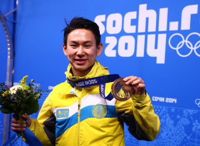 Denis Ten poses with his bronze medal at the Sochi 2014 Olympic Games.