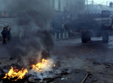 File: Cars on fire on the Falls Road in 1981