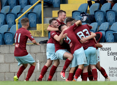 Chris Hull celebrates with team-mates at St Colman's Park.
