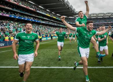 Dan Morrissey (left) celebrates Limerick's All-Ireland final victory.