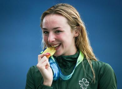 Ellen Keane celebrates receiving a gold medal in the Women's 100m Breaststroke SB8.