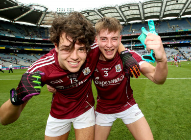 Eoghan Tinney celebrates at the final whistle with Sean Black.