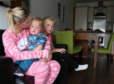 Dublin mother Margaret Cash is photographed with her children after being given access to temporary accommodation.