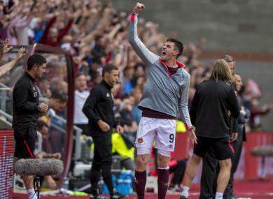 Hearts' Kyle Lafferty celebrates at full time.