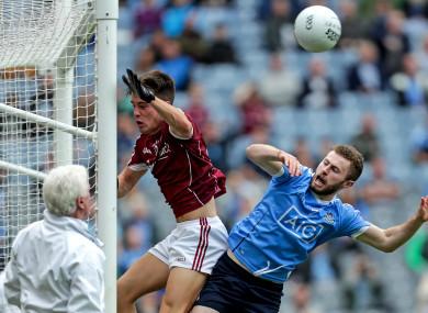 Jack McCaffrey is denied a Dublin goal by Galway's Sean Kelly.