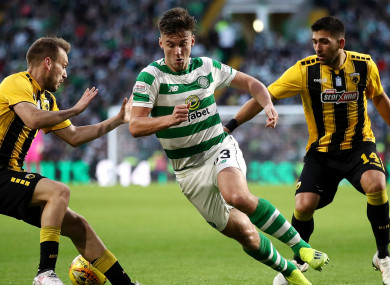 Kieran Tierney is harried during Celtic's clash with AEK Athens.