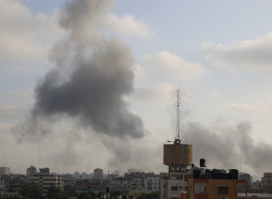 Smoke rises from an explosion caused by an Israeli airstrike in Gaza City yesterday