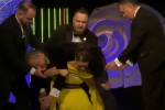 The Westmeath Rose just did a squat with Daithí on her back, because the Rose of Tralee is wild