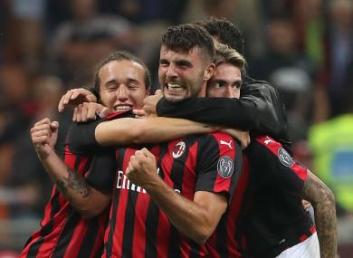 AC Milan forward Patrick Cutrone celebrates