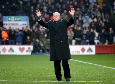 Former Aston Villa manager Ron Saunders salutes the Villa Park crowd in 2006.