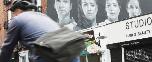 A mural showing four women wearing gaelic football jerseys and the hashtag #SeriousSupport in Dublin city centre today