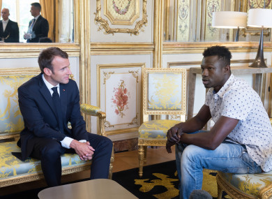 Mamadou Gassama meeting French President Emmanuel Macron after rescuing the boy