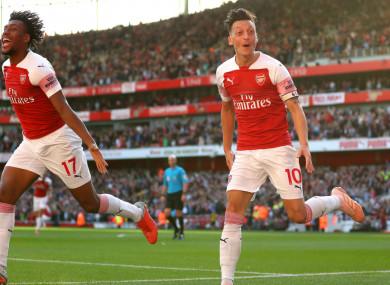 Arsenal's Mesut Ozil celebrates scoring late on Saturday.