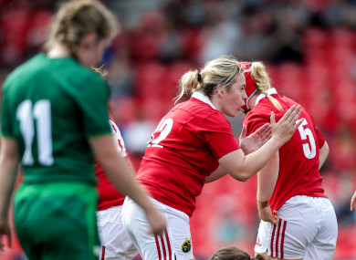 Munster's Niamh Briggs celebrates Chloe Pearse's try.