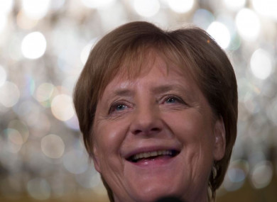 German Chancellor Angela Merkel smiles when answering question today.