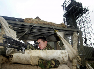 File: A soldier keeps watch as Army sappers dismantle Cloghoge Watchtower in south Armagh, one of two hilltop watchtowers being dismantled in the area
