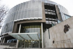 Woman suspected of slicing civil servant�s throat goes on trial