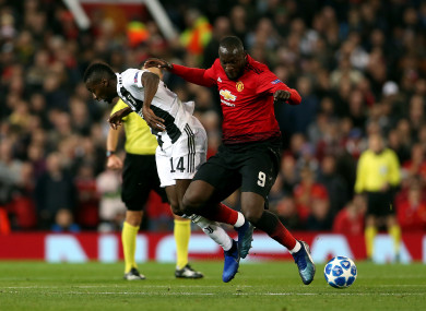 Manchester United's Romelu Lukaku and Juventus' Blaise Matuidi (left) battle for the ball.
