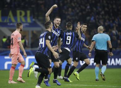 Mauro Icardi celebrates levelling against Barcelona.