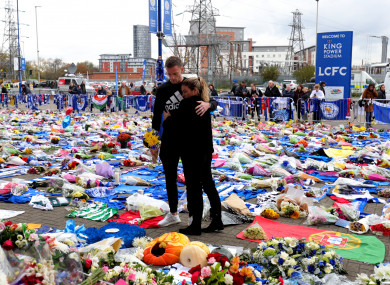 Leicester midfielder Andy King and his wife Camilla pay their respects.