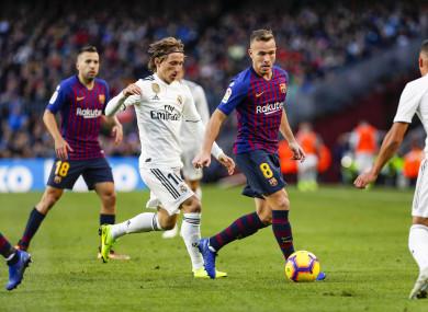 Arthur in action against Real Madrid's Luca Modric in the recent El Clasico.