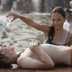 A young couple cool themselves in a fountain at the Exhibition Center in Moscow, on 28 July 2010. (AP Photo/IgorYakunin)
