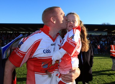 John Mullane kisses his daughter Abby after De La Salle's win over Ballygunner in the Waterford SHC final at Walsh Park on Sunday.