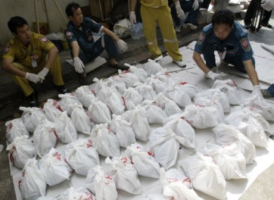 Rescue workers arrange bags containing dead foetuses found at the morgue of a Buddhist temple in Bangkok.