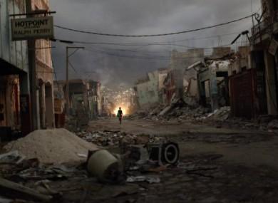 A woman walks downtown in earthquake-torn Port-au-Prince.