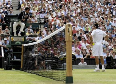 Roger Federer argues with the umpire following Hawk-Eye decision against him, in his match against Spain's Rafael Nadal during The All England Lawn Tennis Championship at Wimbledon.