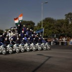 Indian Army daredevils perform stunts on a bike during rehearsals for the upcoming Republic Day, in New Delhi, India on Tuesday.