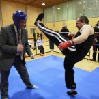 Kickboxing instructor Anthony Dunne shows Sinn Fein's Aengus O Snodaigh a few moves in Dublin. Pic: Julien Behal/PA