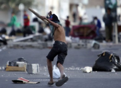 A Shia Bahraini youth holds a piece of wood in the streets of Malkiya, Bahrain, Wednesday, March 16 2011.