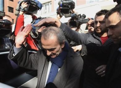 Police detain Mumtaz Idil, the Ankara representative of the anti-government Oda TV, second left, in Ankara, Turkey.