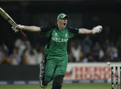 Kevin O'Brien celebrates his record-breaking century during the Cricket World Cup match against England