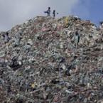 Impoverished Somali children sift through a mountain of garbage in Mogadishu's southern Hamarjajab neighborhood. Pic: AP Photo/Farah Abdi Warsameh.