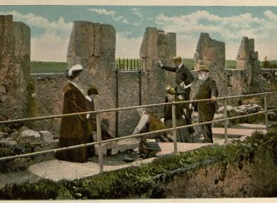 A tourist postcard depicting the Blarney Stone c. 1900