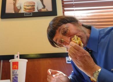 Don Gorske, 59, a retired prison guard, eats his 25,000th Big Mac.