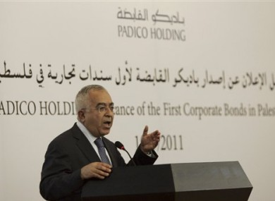 Palestinian Prime Minister Salam Fayyad speaks at a ceremony announcing the first Palestinian commercial financial bond, in the West Bank city of Ramallah, Tuesday, May 10, 2011.