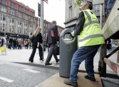Bins get binned! Council workers remove rubbish bins on O'Connell Street in Dublin ahead of the Queen's visit.